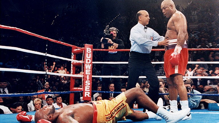Foreman knocks out Michael Moorer