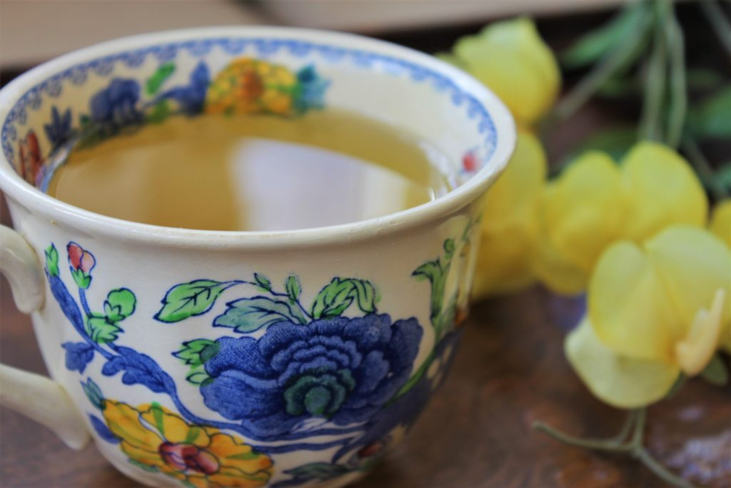cup of yellow herbal tea