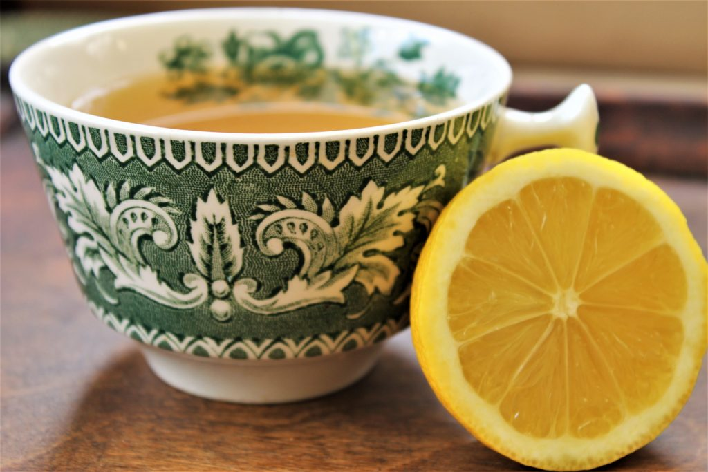 Lemon wedge with green tea cup