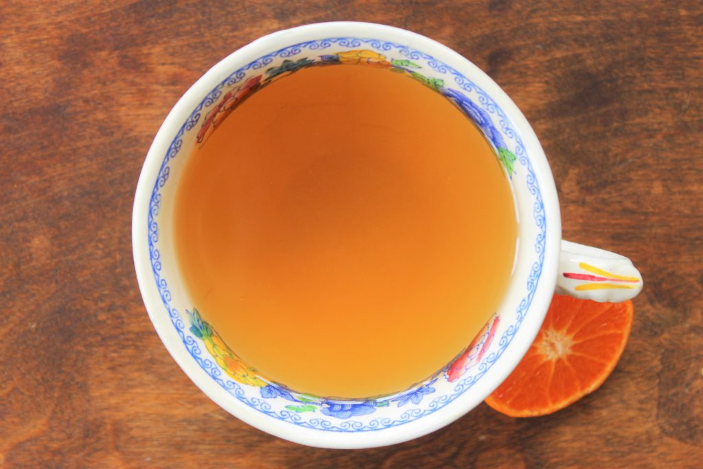 orange and fennel tea in a vintage tea cup