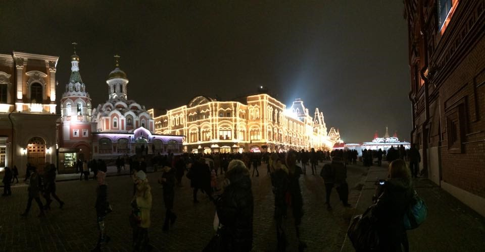 A view from inside Red Square, Moscow, Russia. Looking at the Gum department store. Behind is the mausoleum of Lenin. Taken at night.