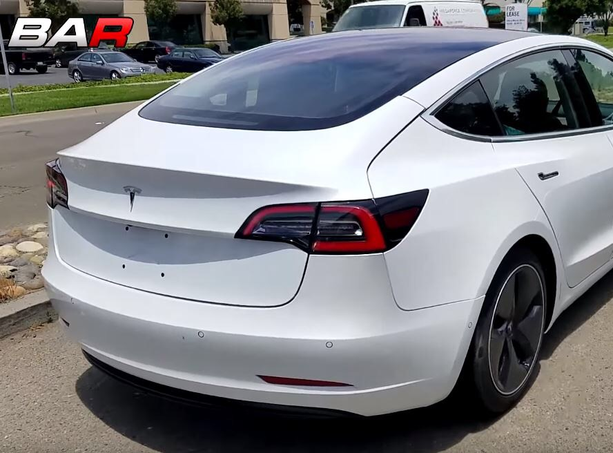 White Tesla with obvious panel gap and panel misalignment