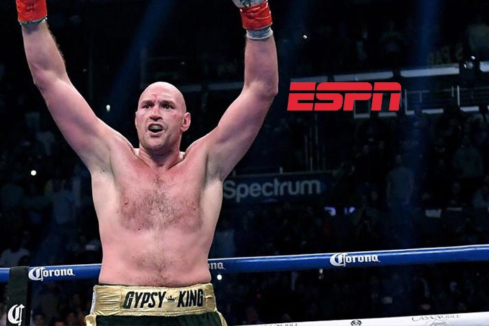 Tyson Fury raises his arms after facing off with Deontay Wilder