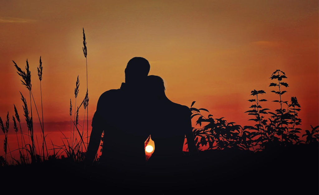 Two lovers enjoy the sunset