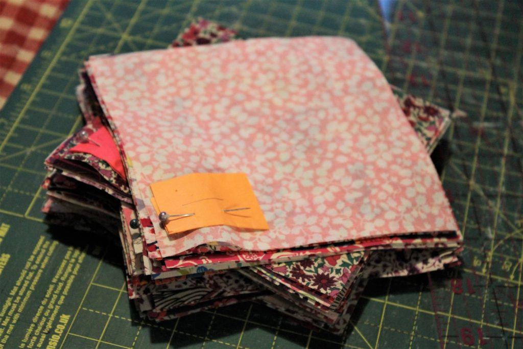 pile of pink quilt fabric