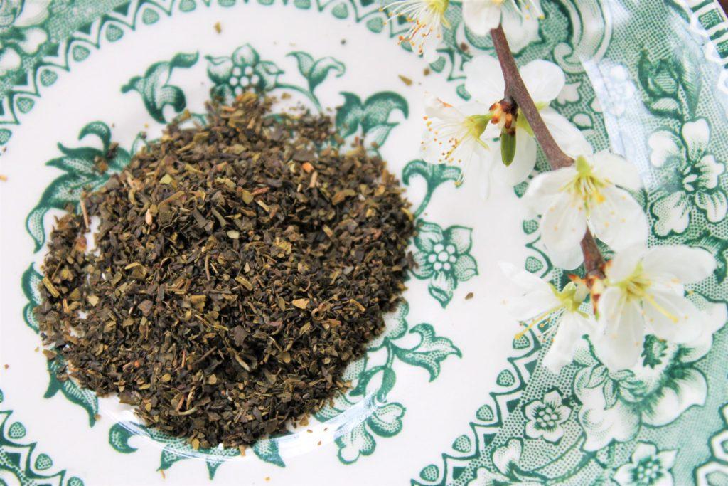 green tea with jasmine leaves