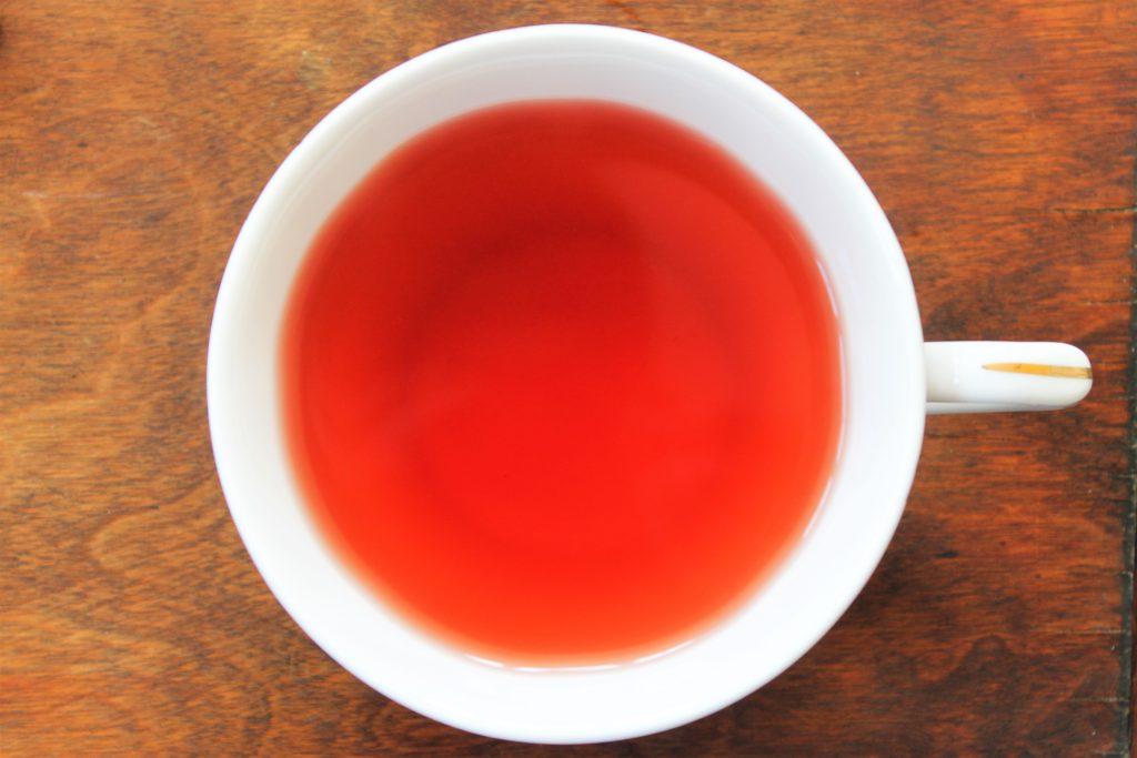 elderberry tea in a white cup