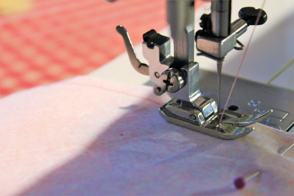 sewing pink thread through pink fabrics with a sewing machine