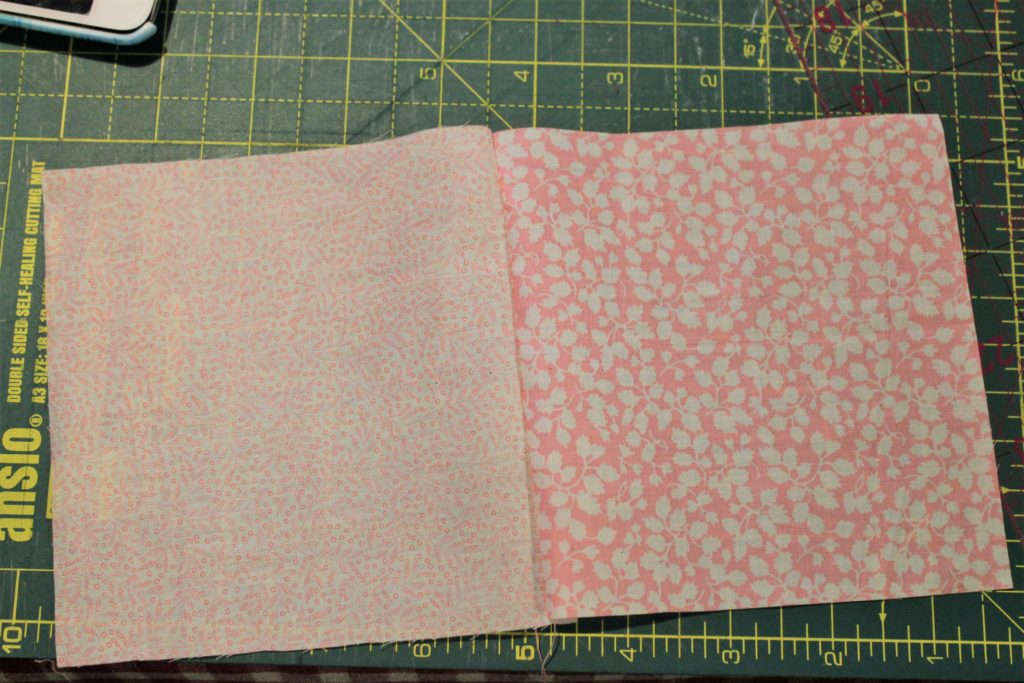 two pink quilt squares sewn together