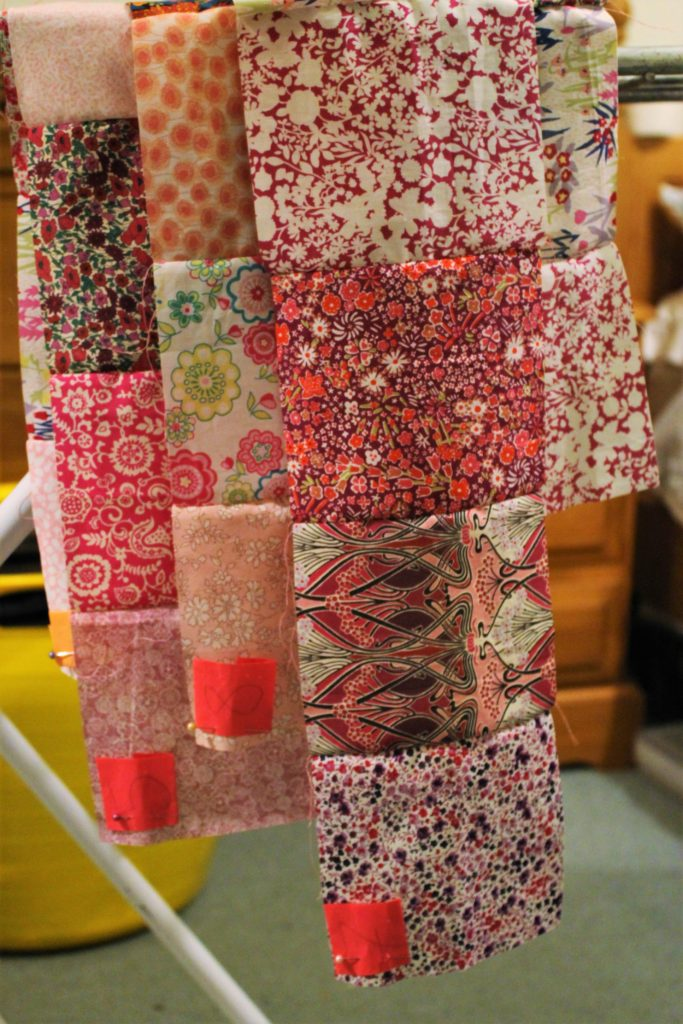 long rows of pink quilt squares sewn together