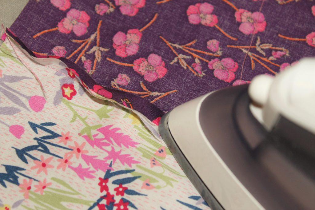 ironing pink quilt seams
