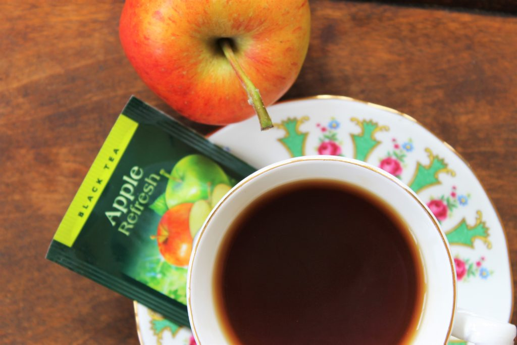 dark brown tea with apple and tea bag