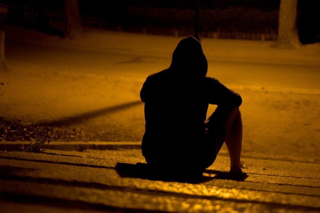 man sitting on the curb