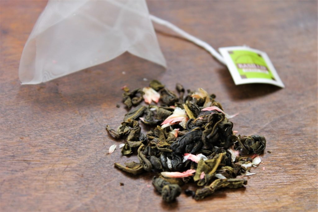 green tea with pink petals