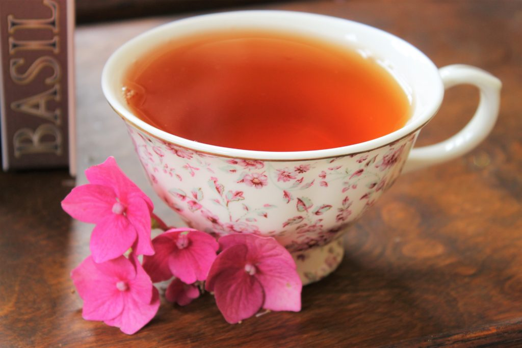 rose and almond tea in pink teacup