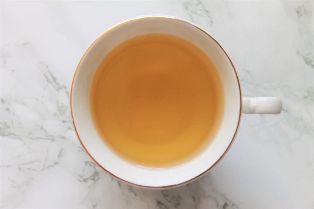 yellow tea in teacup