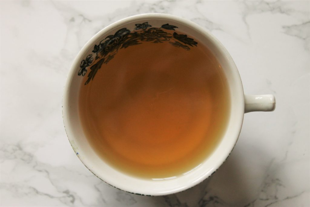yellow orange tea in cup