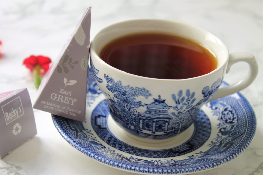 earl grey in blue china tea cup